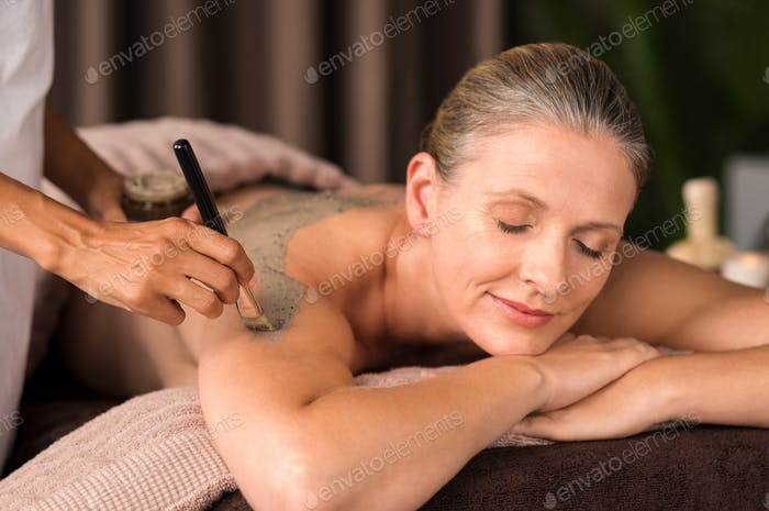 Woman relaxing during mud treatment