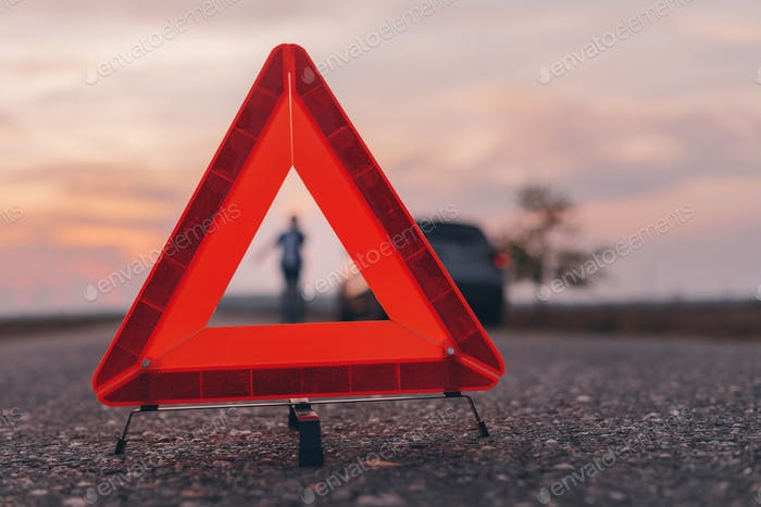 Warning triangle sign on the road