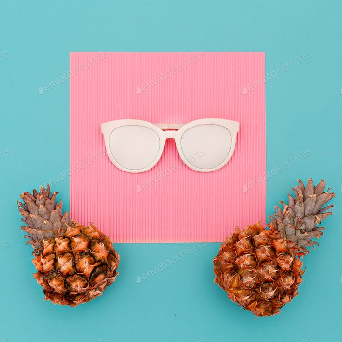 Two pineapples and sunglasses. Beach concept. Minimal art design