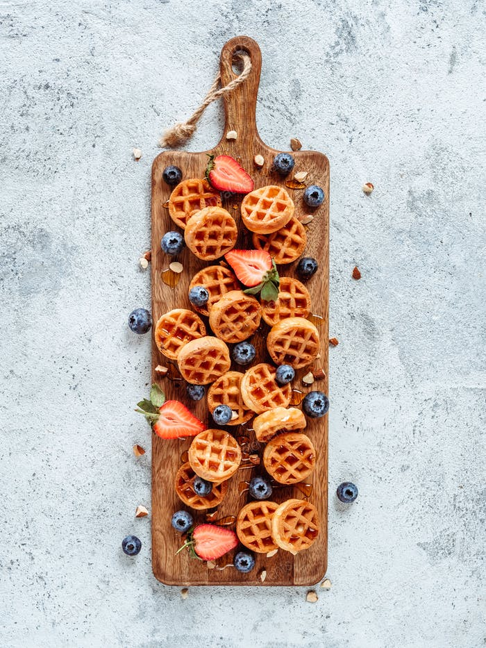 Delicious belgian waffles with berries, copy space