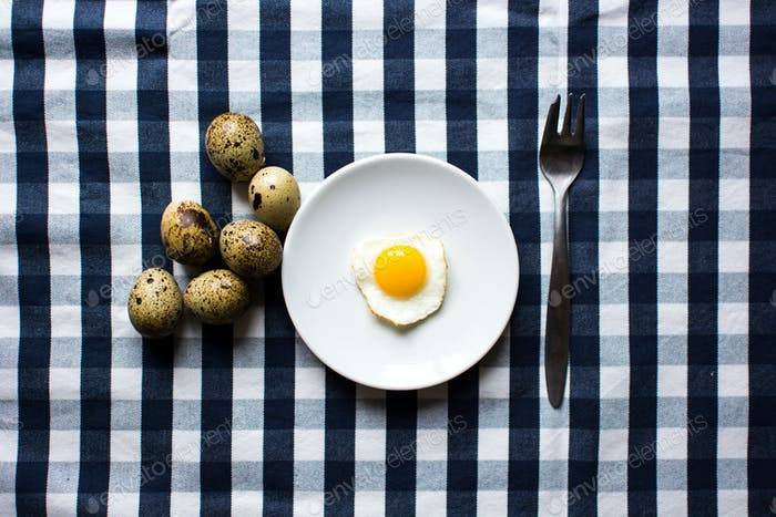 Quail egg sunny side up