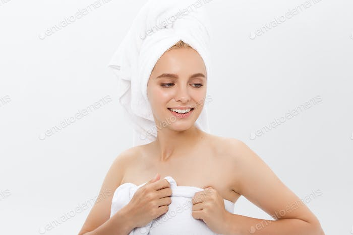 Beautiful woman in a white towel on a head isolate on white