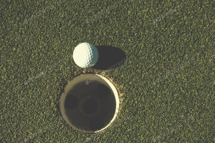 top view of golf ball in the hole
