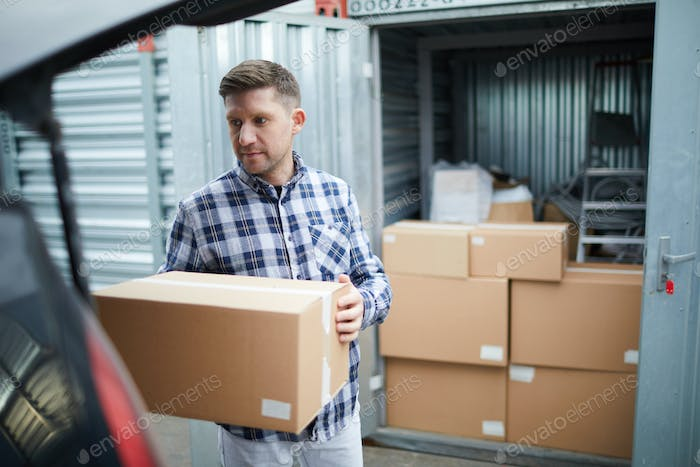 Man storing things in container