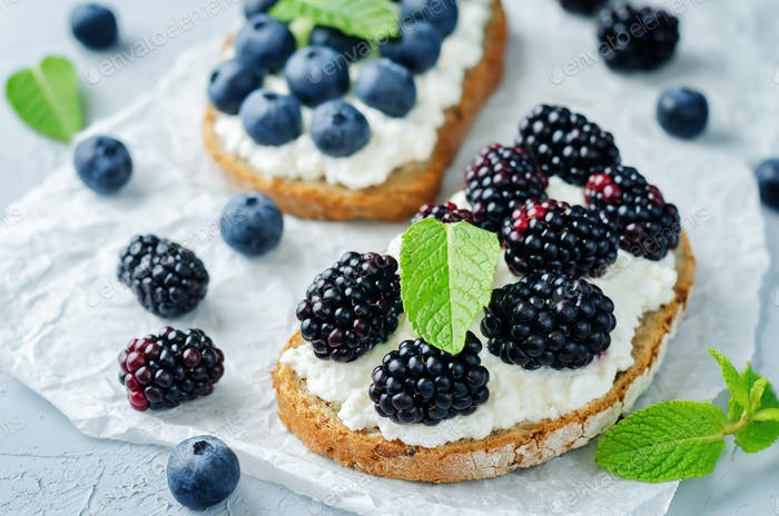 Blueberry and blackberry ricotta rye sandwiches