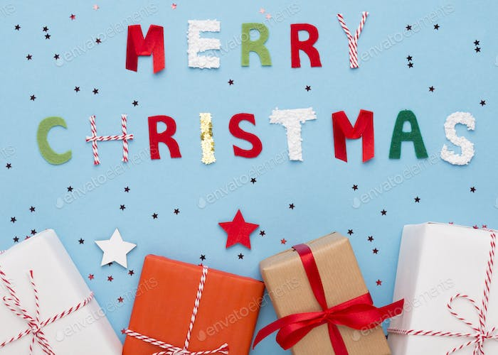 Merry Christmas wishes and gifts in boxes on blue background