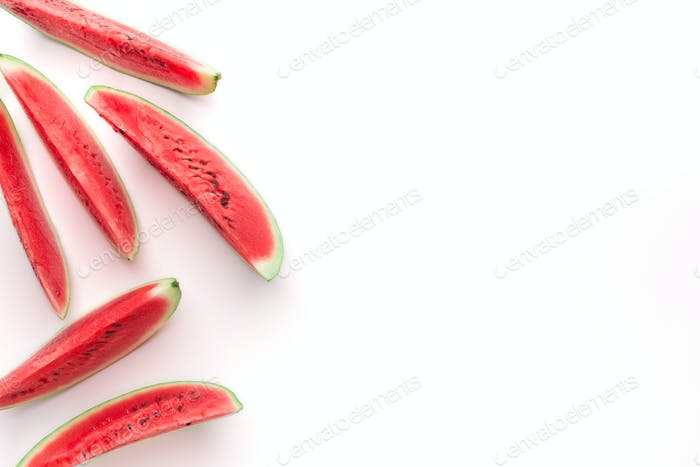 Sliced juicy watermelon isolated on white background