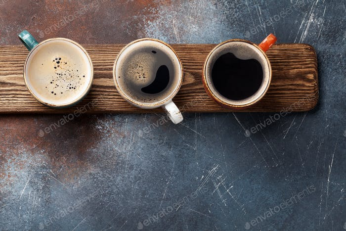Coffee cups on wooden board