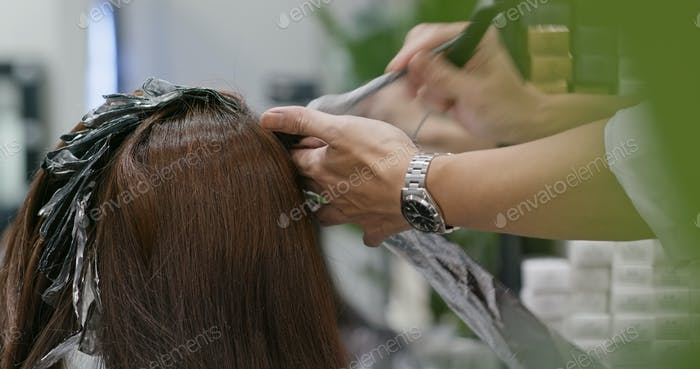 Woman having hair coloring in a beauty salon