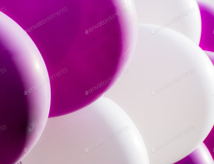 Bunch of purple and white balloons