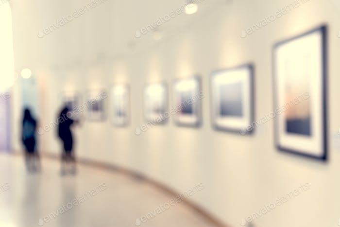 People enjoying an art exhibition