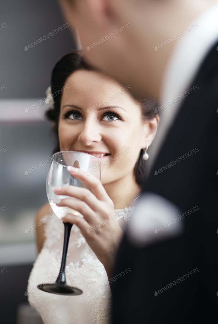 Elegant woman drinking wine at a function