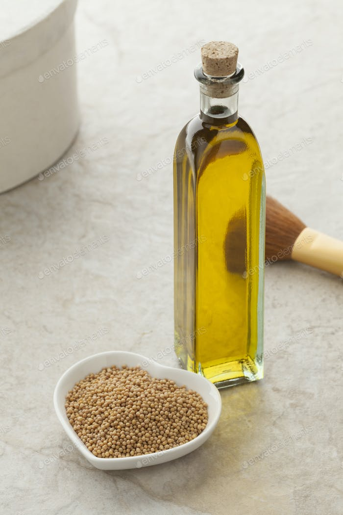 Bottle with mustard oil and seeds