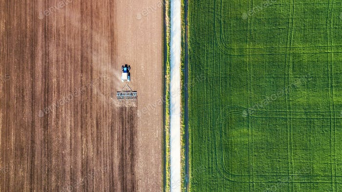 The tractor's in the field. Agricultural landscape from the air.