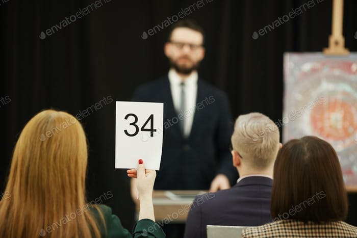Woman sitting at auction