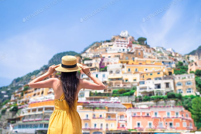 Summer holiday in Italy. Young woman in Positano village on the background, Amalfi Coast, Italy