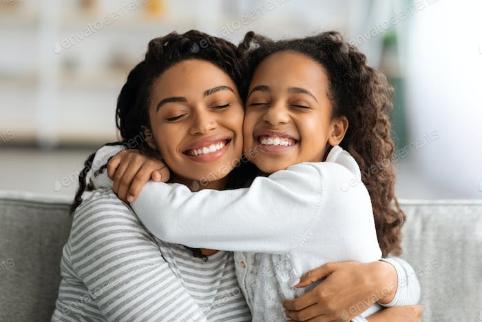 Closeup portrait of bonding african american mother and daughter