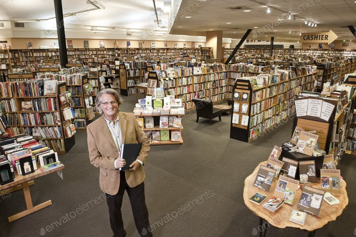 Portrait of a caucasian male owner of a large bookstore