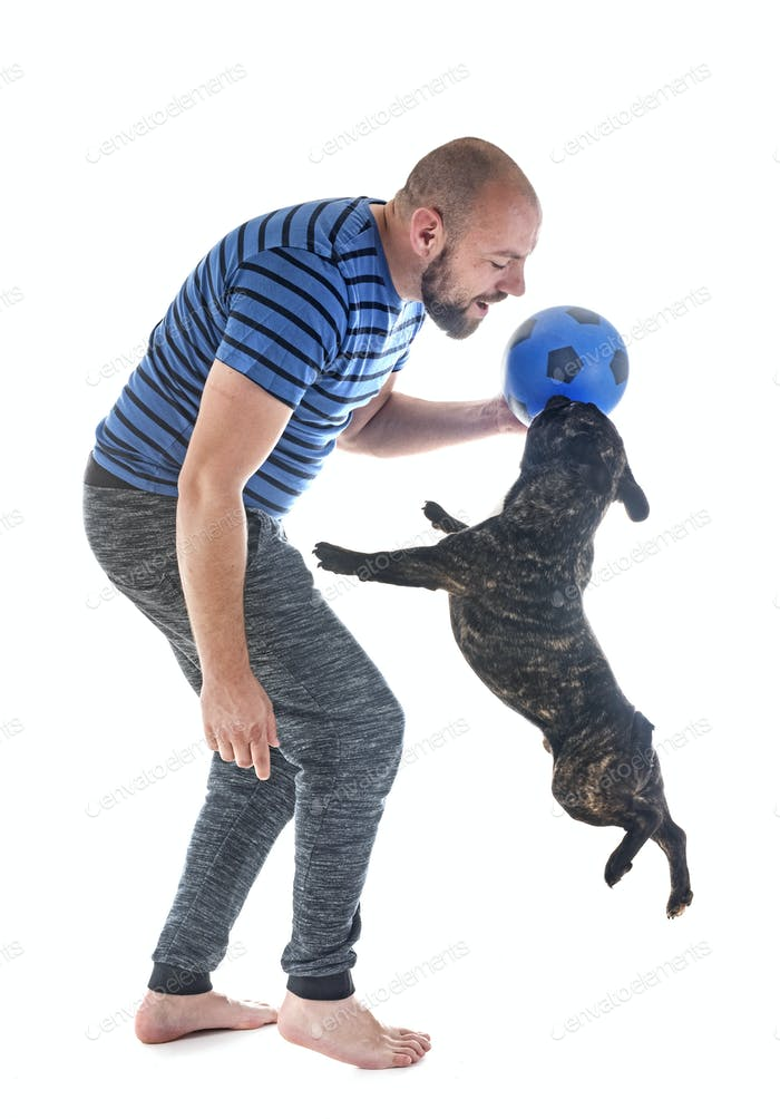 man playing with dog
