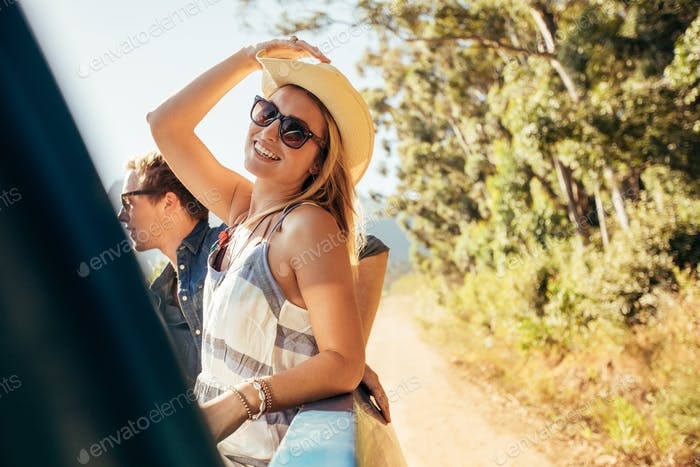 Attractive woman in the back of truck with friends