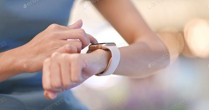 Woman use of smart watch inside shopping center