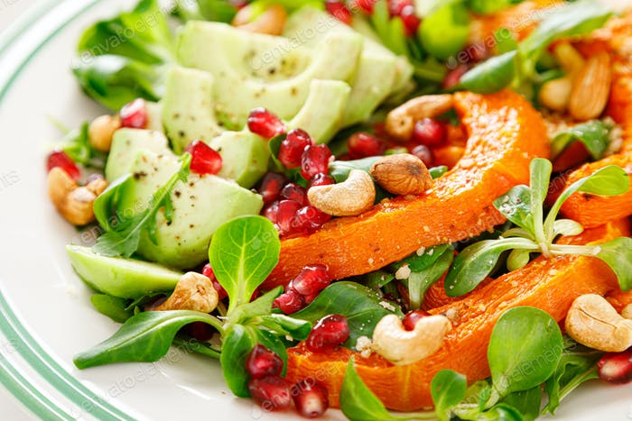 Fresh vegetable salad with, pumpkin, avocado and almond nuts