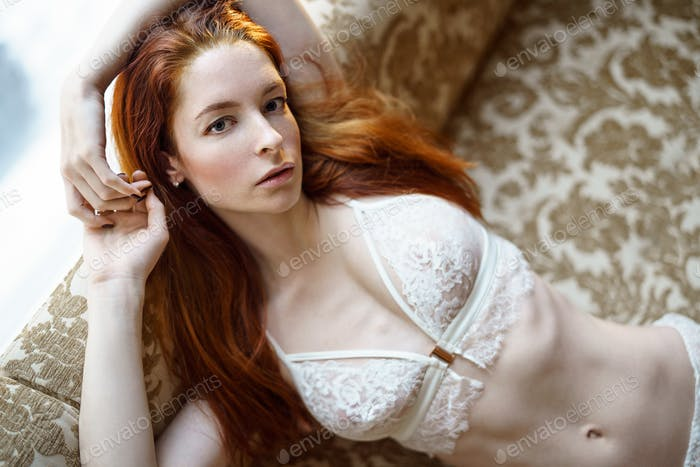 Fashionable female portrait of cute lady in white bra indoors