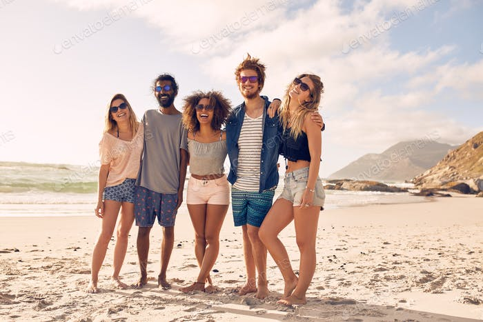 Happy young people enjoying a day at beach