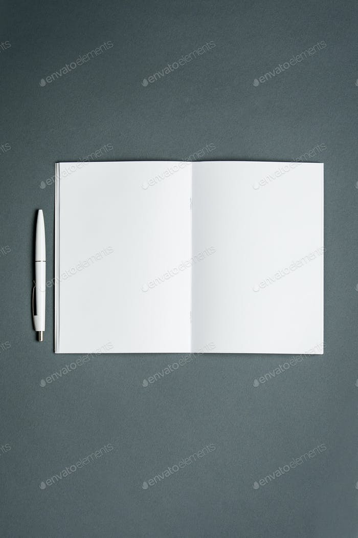 Mock-up business notebook. Gray background.