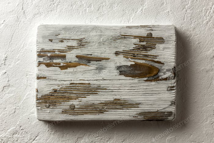 Old rustic white wood board on grunge concrete table