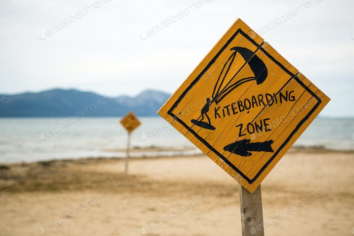 Kiteboarding, wooden kitesurfing sign on beach