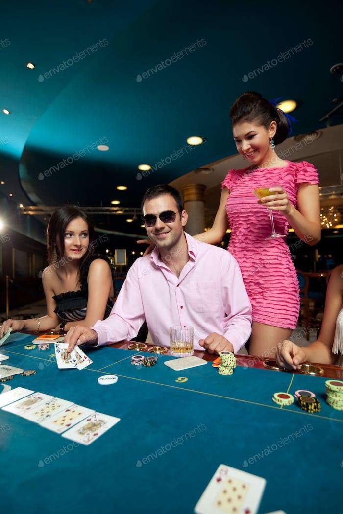 man winning poker three of a kind formation