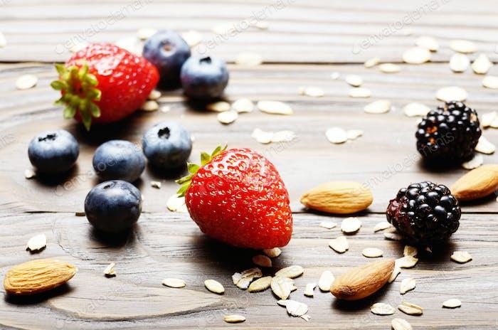 Ripe organic strawberries, blueberries, blackberries almonds and