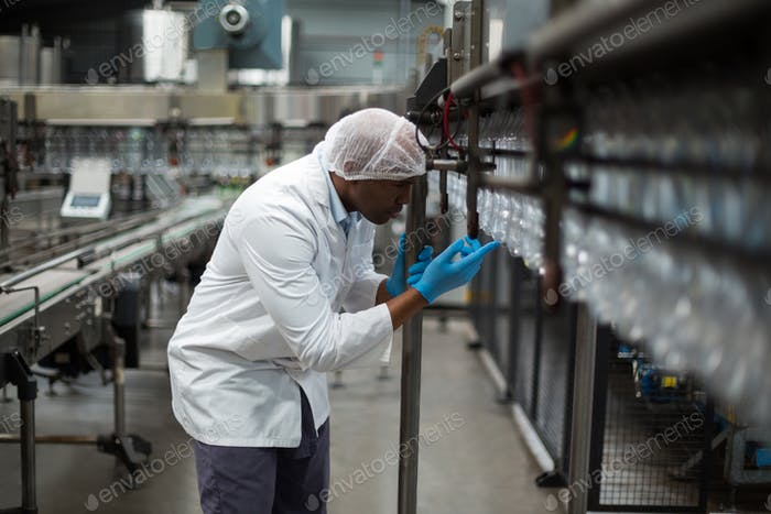 Factory engineer counting bottles