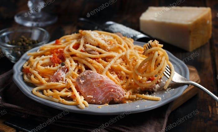 Pasta with chunks of fresh tuna, tomato and capers