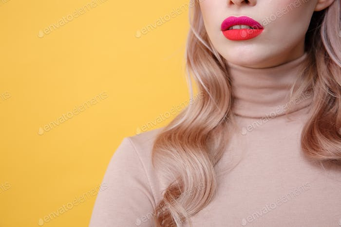 Cropped photo of young blonde lady with bright makeup lips