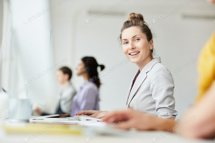 Cheerful Businesswoman at Workplace