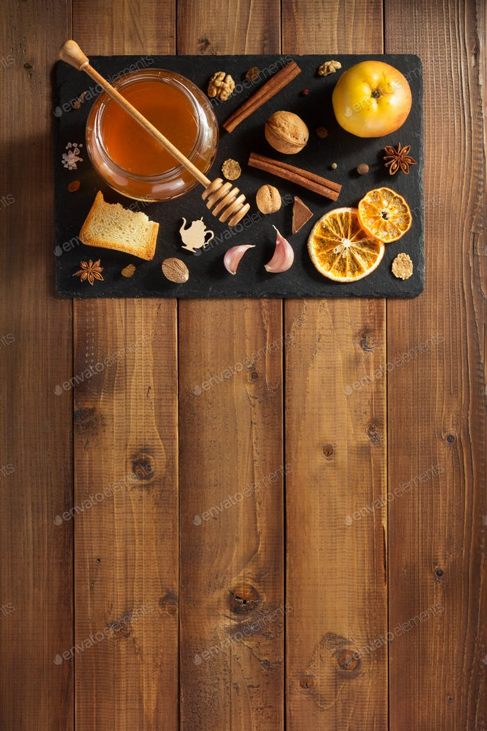 glass jar of honey on wood