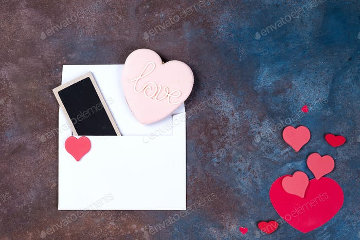 White envelope with hearts on stone background. Valentine's day background. Love concept