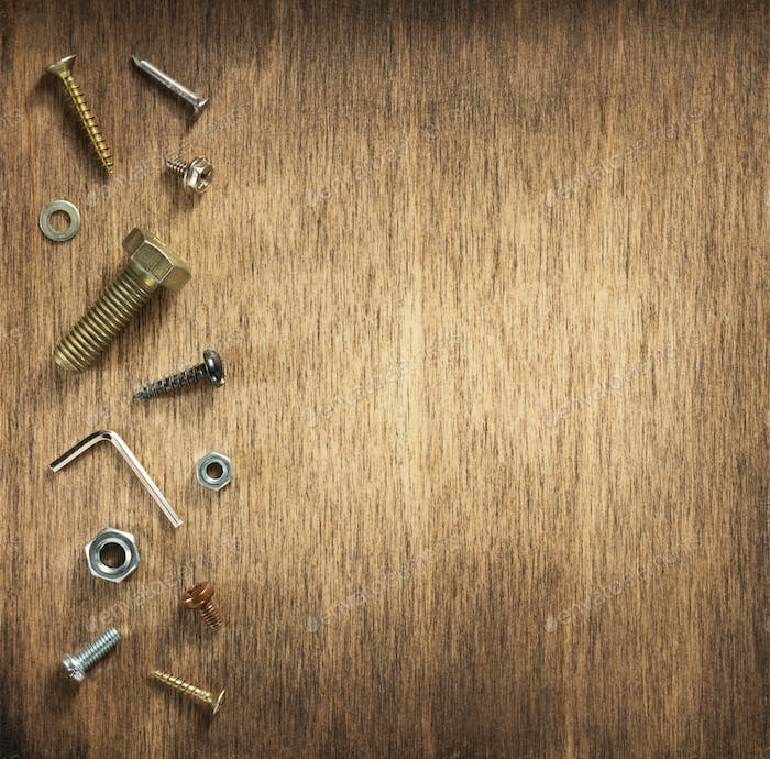 hardware tools and screws at wood