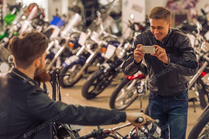 Men in motorbike salon