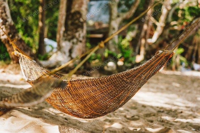 a handmade hammock on the beach during summer holiday