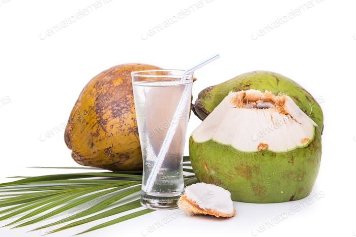 Refreshing green coconut fruit juice in glass on white backgroun