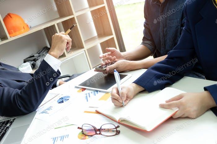 Executives listened to employee analyzed work.
