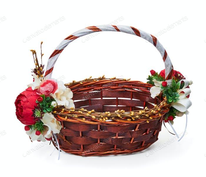 Festive basket with a flower arrangement on white background
