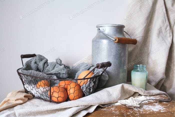 Ingredients for a cake on a white cotton fabric