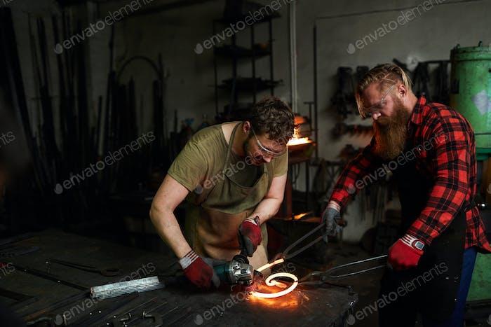 Men working in smithy
