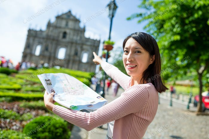 Woman pointing to the destination in Macao