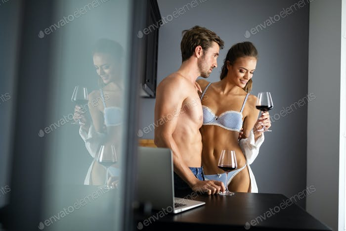 Beautiful woman and handsome muscular man close to each other in erotic pose