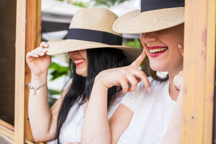 Close up portrait of young caucasian couple of girls smile